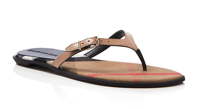 af95ef29fb07 The classic flip flop gets a Burberry makeover  a splash of the classic  House check and a patent leather strip with a brass buckle.